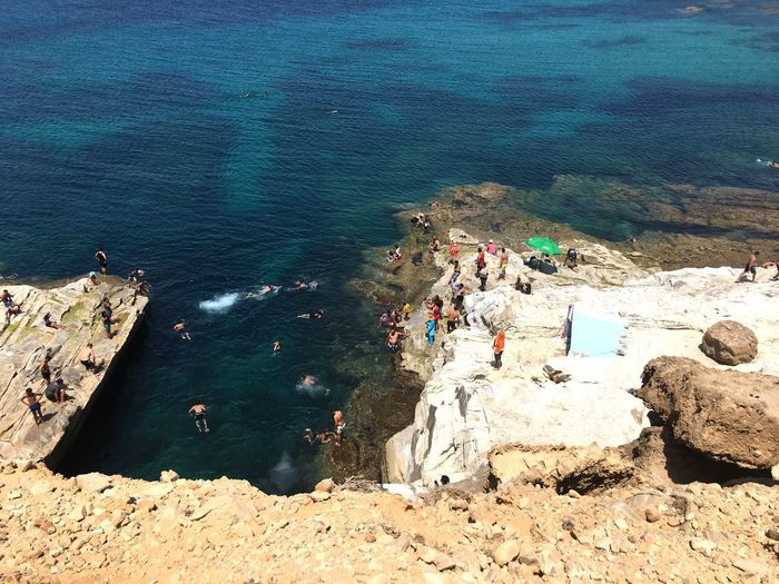 EyeEmNewHere Hometown Sunshine Swimming Diving Blue Sky Sea Climbing Cliffs Happypeople Bizerte Tunisia Beach Water High Angle View Sand Sea Day Outdoors Nature Sunlight Beauty In Nature