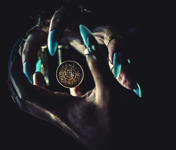 1919 Indian coin Human Hand Hand Human Body Part Indoors  Holding Close-up Real People Human Finger One Person Finger Dark Jewelry Body Part High Angle View Lifestyles Personal Perspective Shiny Adult Nature Luxury