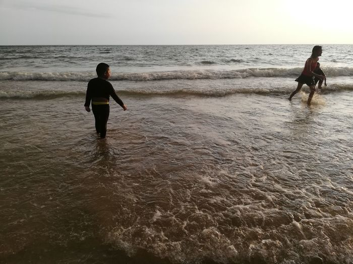 Children enjoy on summer trip 2019,หาดเจ้าหลาว Achi2019 Sea Water Horizon Over Water Horizon Beach Sky Land Real People Beauty In Nature Leisure Activity Scenics - Nature Motion Nature Lifestyles People Wave Men Rear View Day Outdoors