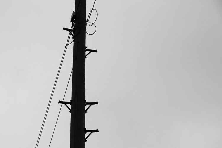 Black And White Clear Sky Coil Connection Copy Space Day Fuel And Power Generation Loops Low Angle View No People Outdoors Sky Steps Technology Telegraph Pole Telegraph Wires