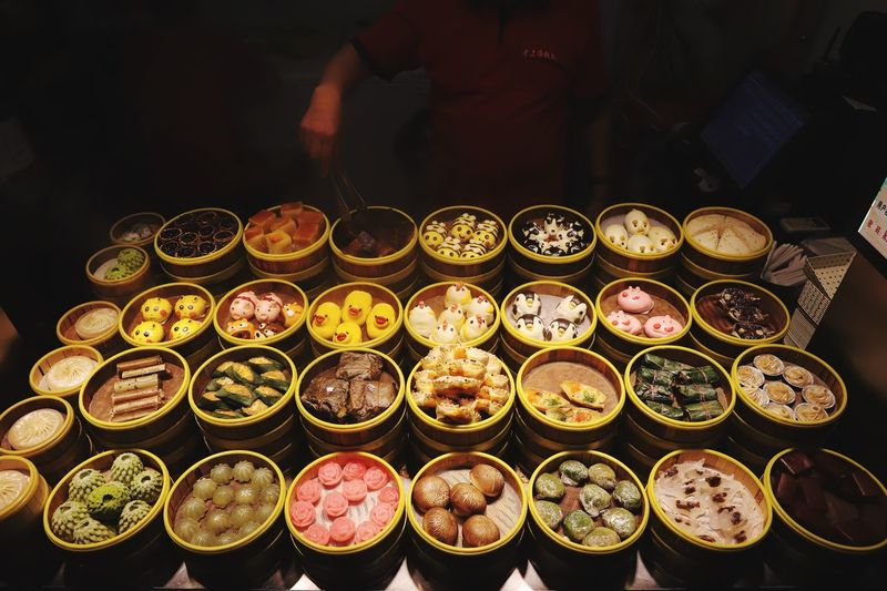 Colourful chinese steamed buns at the street food market in beijing