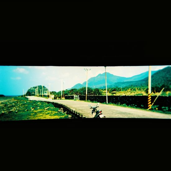 Aboriginal Land Lomography Tao  Bicycle Copy Space Day Environment Field Land Land Vehicle Landscape Mode Of Transportation Mountain Nature One Person Outdoors Real People Riding Road Sky Sport Transportation