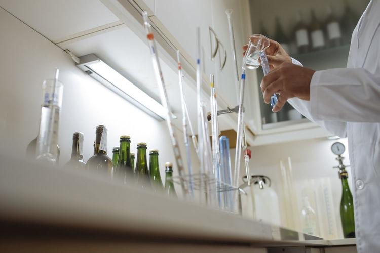 Man holding glass of bottle