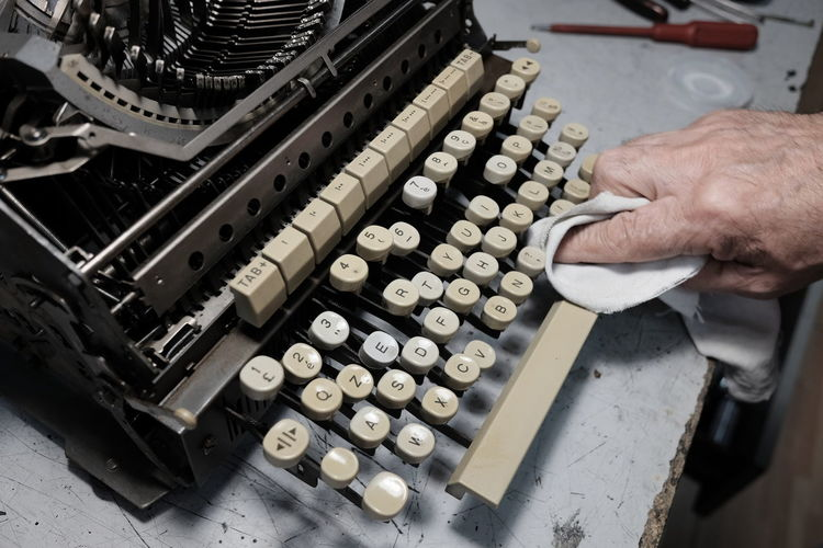 Cropped Hand Cleaning Typewriter
