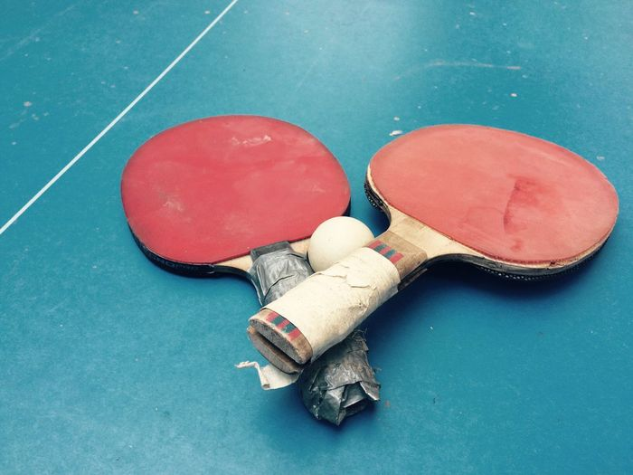 High angle view of table tennis rackets on table