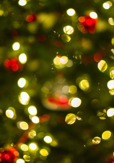 Defocused image of illuminated christmas tree