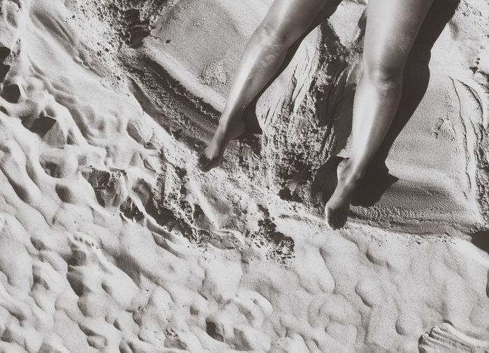 Legs on sand