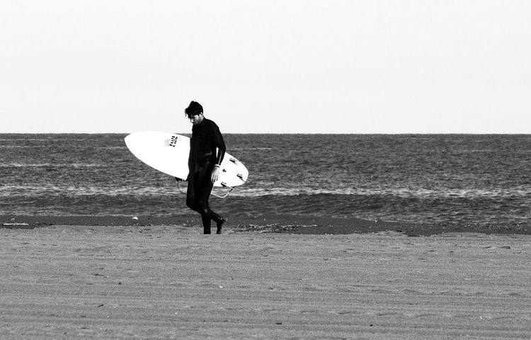 Beach Beauty In Nature Black And White Clear Sky Day Disappointment Full Length Horizon Over Water Leisure Activity Loneliness Men Nature One Man Only One Person Outdoors Real People Sea Sky Spain, Andalucia, Malaga Sport Surfboard Surfer Torremolinos