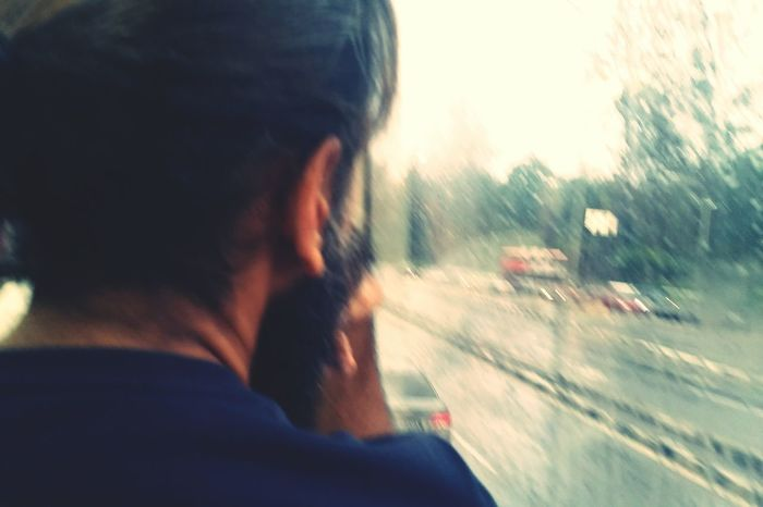 A man sitting in front of me in the bus... pondering... looking out of the window on a rainy day... Up Close Street Photography Telling Stories Differently Looking Out Looking Out Of The Window Bus Bus Ride In The Bus Rainy Day Raining Streetphotography Street Photography From My Point Of View Eye4photography  EyeEm Best Shots EyeEm Gallery Capture The Moment Blur Real People Man With Long Hair Man Bun Streetphoto_color Beard Beardman IPhoneography PhonePhotography