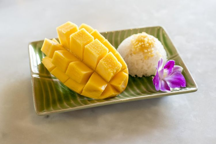 Freshness Flower Flowering Plant Food Food And Drink Sweet Food Indoors  Yellow Close-up No People Indulgence Sweet Dessert Mango Fruit High Angle View Wellbeing Plate Still Life Temptation Tray Mango Sticky Rice Mango
