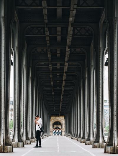 People Walking Under Bridge