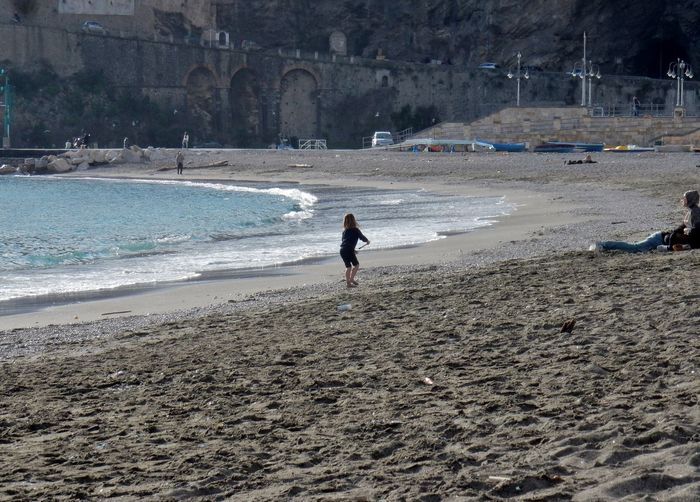 Beach Land Sea Water Sand Real People Leisure Activity Lifestyles People Incidental People Full Length Nature Motion Outdoors Day Holiday Walking Child Amalfi Coast