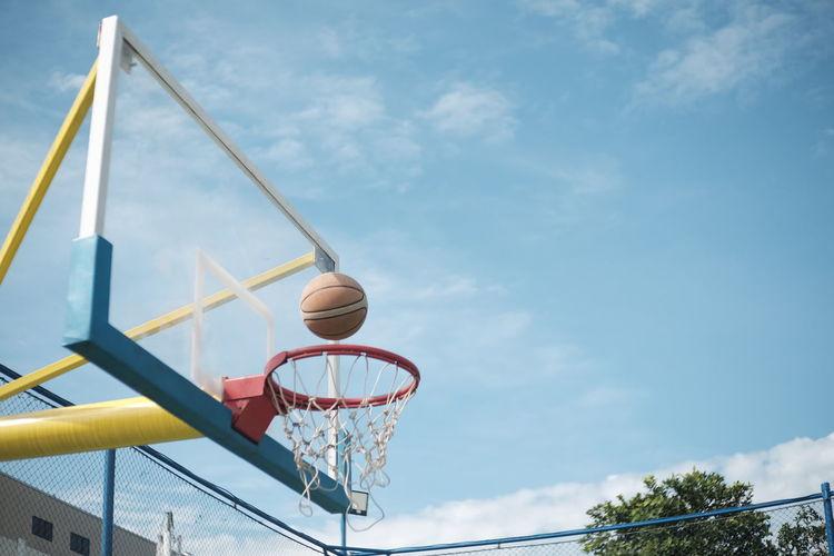 Basketball on ring, Cikarang 2017 Basketball - Sport Basketball Hoop Low Angle View Sport Outdoors Basketball Basketball Ring Cloud - Sky Sky Cikarang INDONESIA Nature Day