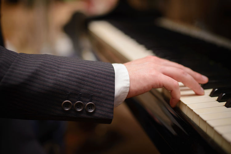 Hand of piano player Adult Artist Arts Culture And Entertainment Focus On Foreground Hand Human Body Part Human Hand Indoors  Keyboard Keyboard Instrument Men Music Musical Equipment Musical Instrument Musician One Person Performance Pianist Piano Piano Key Playing Skill