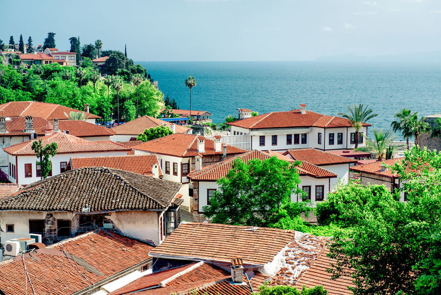 Antalya cityscape. Turkish resort Antalya Turkey Architecture ASIA City Cityscape Coast Houses Landscape Mediterranean Sea Middle East Nature Outdoors Rooftops Scenery Sea South Summer Tourism Town Travel Destinations Trees Tropical Climate Turkey Turkish Riviera Urban Landscape