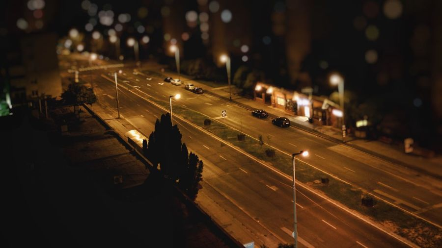 Vehicles on road at night