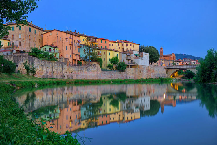 Blue hour over Umbertide, Italy Architecture Blue Building Building Exterior Built Structure Clear Sky History House Italy Lake Nature No People Old Outdoors Reflection Residential District Sky The Past Travel Destinations Umbertide Water Waterfront