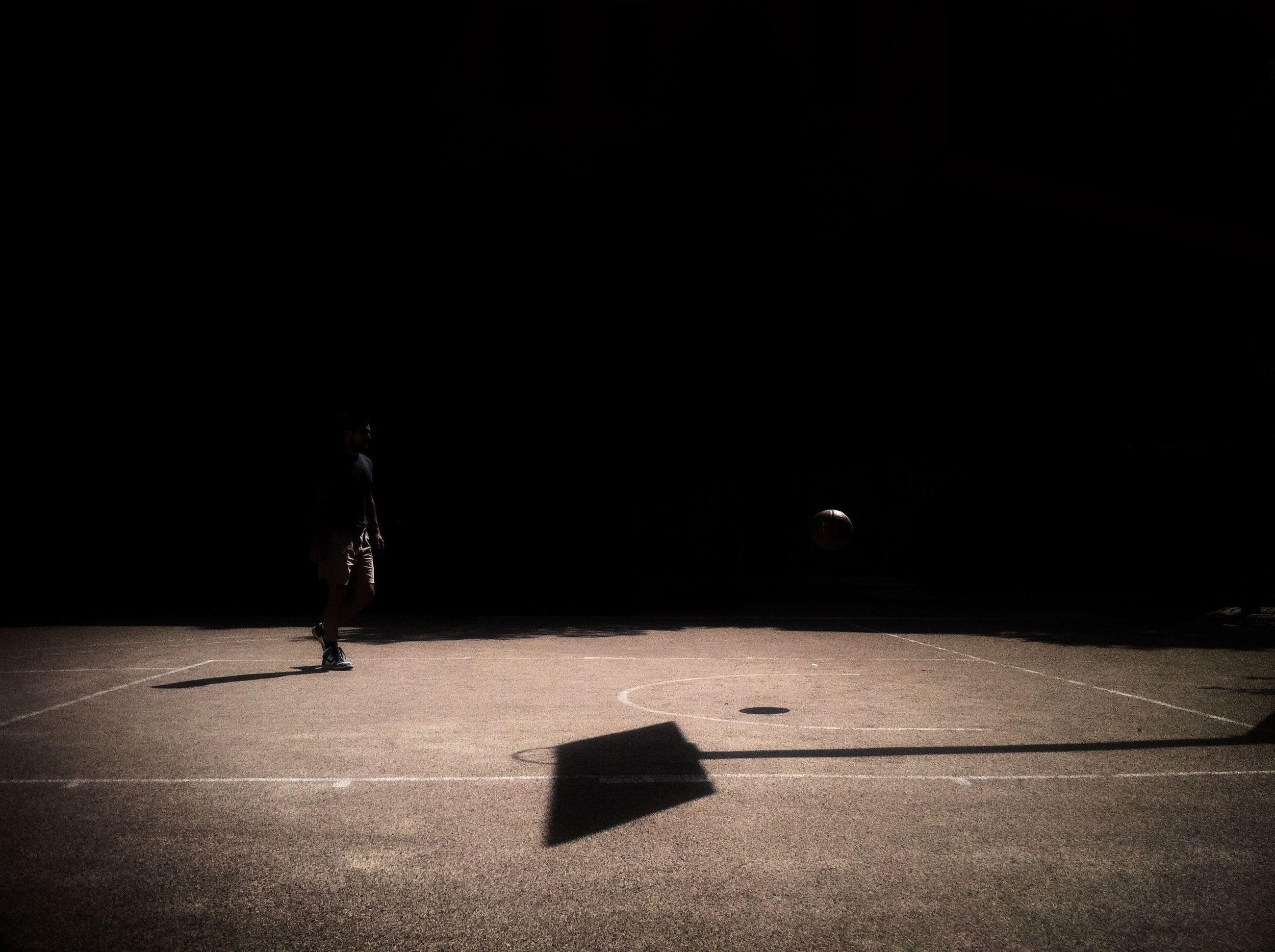 night, dark, illuminated, copy space, indoors, shadow, silhouette, street, light - natural phenomenon, road, transportation, empty, lighting equipment, darkness, side view, full length, darkroom, lifestyles