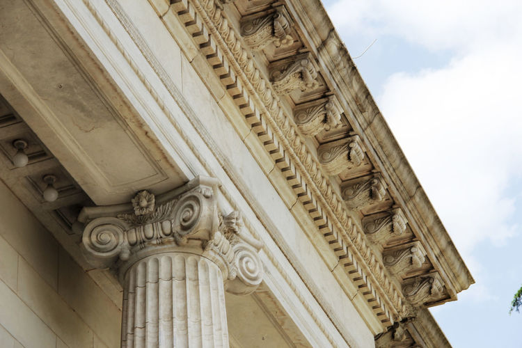 Eaves Architecture Built Structure Low Angle View Building Exterior No People Architectural Column The Past History Sky Cloud - Sky Day City Design Ornate Classical Style Decorative Historical Building Historical Stone Material