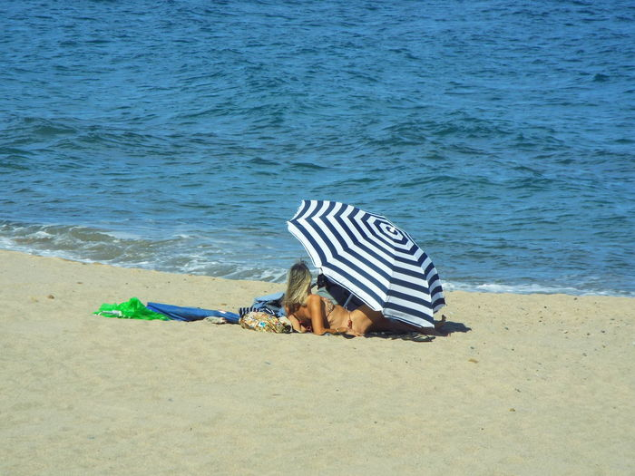 Beach Beauty In Nature Blue Day Hollidays Lying Down Nature Outdoors Relaxation Resting Shore Tranquility Water