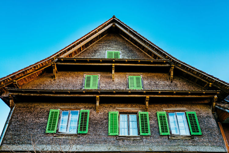 Architecture Balcony Blue Building Building Exterior Built Structure Clear Sky Day Façade Gormund House Kapelle Low Angle View No People Outdoors Residential Building Residential Structure Roof Sky Sunlight Window Wood - Material