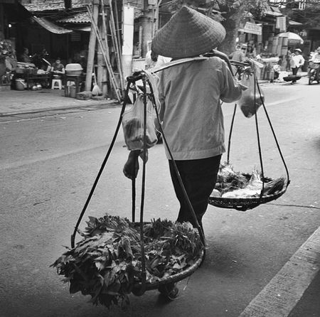 Guess The Country!? People Photography Watchingpeople Manatwork PeopleAroundTheWorld Blackandwhite Travel Photography Walking Around Taking Pictures Streetphotography City Life City Street Hanoi Street Hanoifood Streetfood