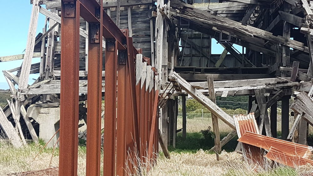 Wood - Material Day Outdoors Built Structure No People Sky Rusty Metal Wire Safety Exclusion Rural Scene Security Wonthaggi Old Mineworks Chainlink Fence Warning Sign Keepout Protection Dilapidated Building Falling Down
