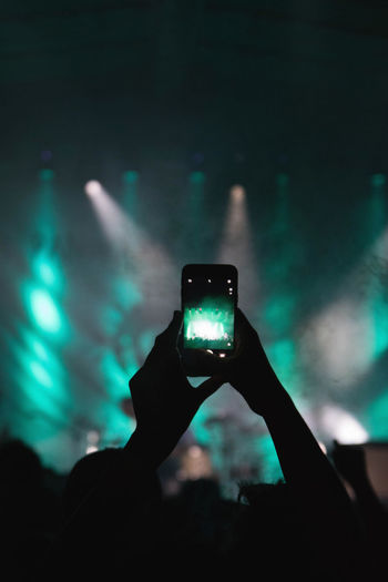 Silhouette Hands Photographing Music Concert With Smart Phone