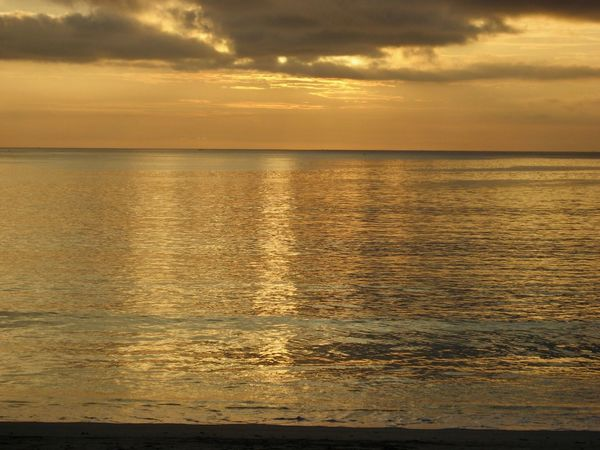 Sunset Sea Scenics Beauty In Nature Water Tranquility Tranquil Scene Nature Cloud - Sky Sky Horizon Over Water Reflection Idyllic No People Outdoors Silhouette Beach Day