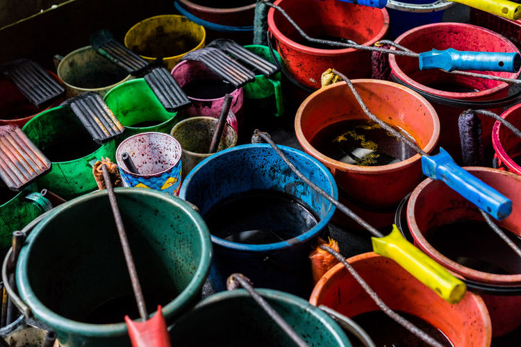 High angle view of colorful buckets