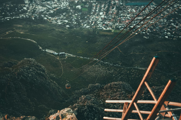 High Angle View Of Overhead Cable Car Over Mountains And Landscape