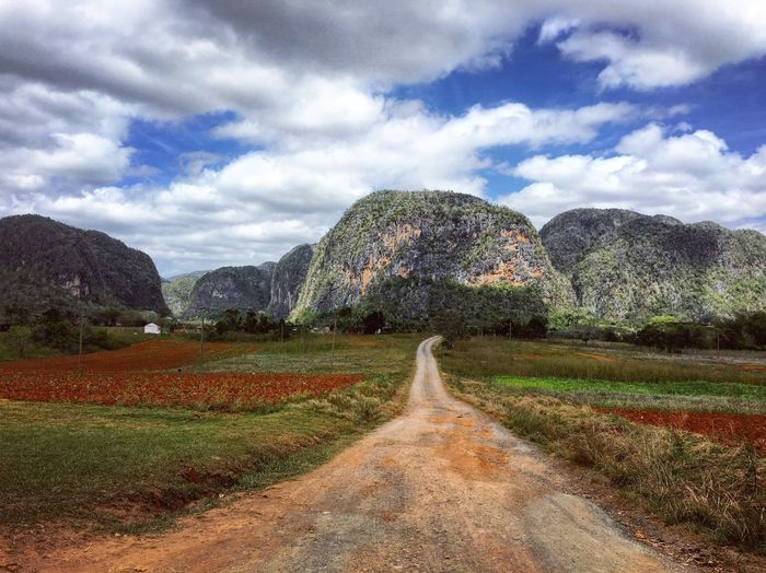 The stark beauty of Viñales, Cuba. Lots of hiking, climbing, cycling and not to forget much of the tobacco for cigars is grown around here. Cuba Viñales Nature Photography Landscape_Collection Landscape Landscape_photography EyeEm Nature Lover Eye4photography  Road IPhoneography Mountains Taking Photos Enjoying Life Travel Photography Sky And Clouds