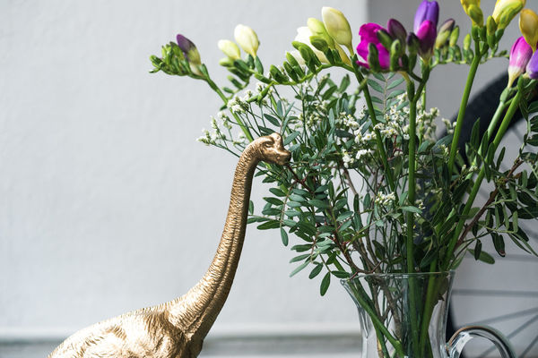 Golden dinosaur eating my flowers Funny Humor Lifestyle Plant Unusual Animal Close-up Cute Day Decoration Dinasour Diplodocus Flowers Focus On Foreground Glass Vases Gold Colored Hipster Interior Leaf Model Pink Color Plastic Still Life Toy