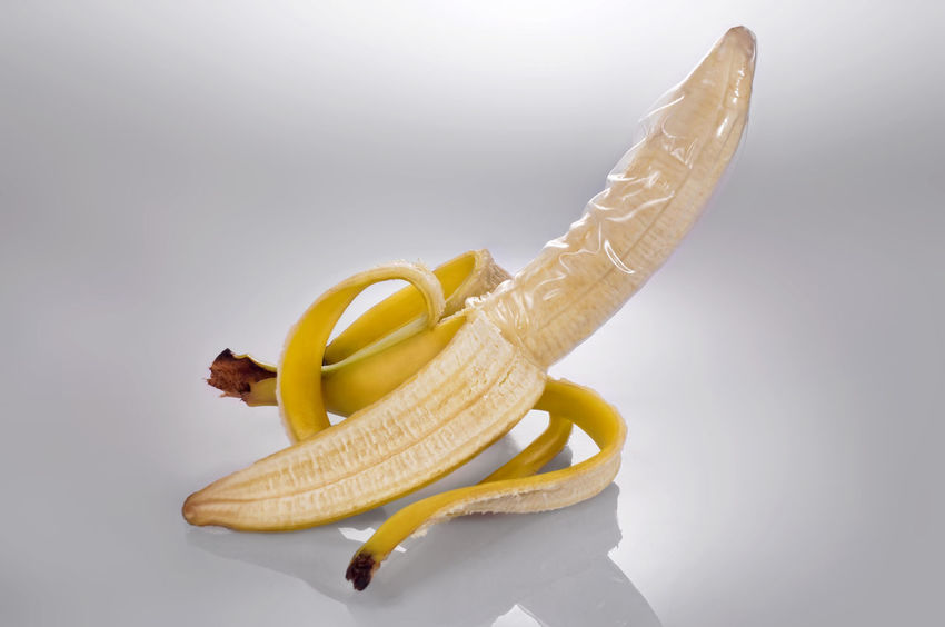 Banana wearing condom protection Condom Protection Contraception Banana Peel Yellow Banana Close-up Food And Drink Peeled Peeling Off