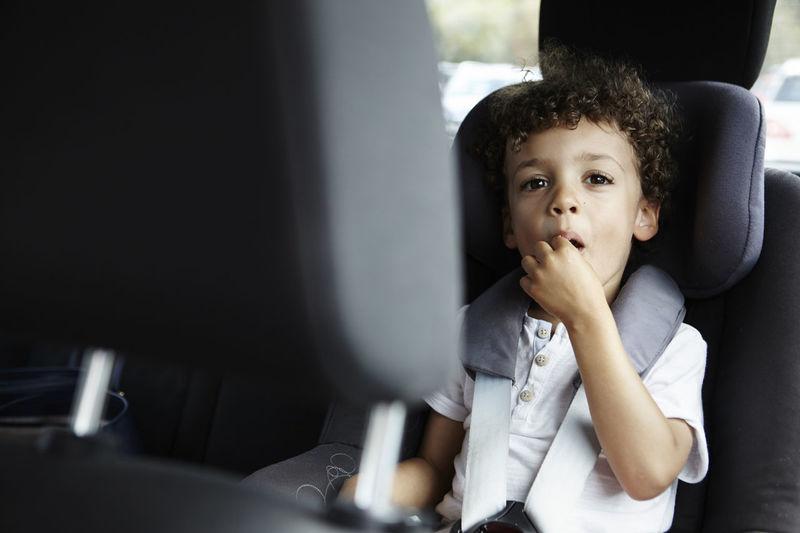 Portrait of boy sitting in bus