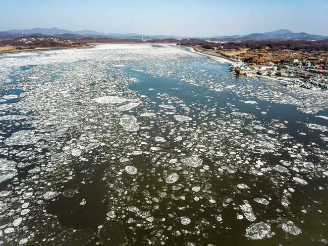 Drift ice of Choji Bridge in Kanghwa island, Korea. Harbor Dongmyung Sea Ice Lighthouse Korea Winter Drone Shot Ganghwa Island Winter WinterSea Water Nature Sea Sky Day Beach Land Tranquility Beauty In Nature Scenics - Nature Tranquil Scene Outdoors High Angle View
