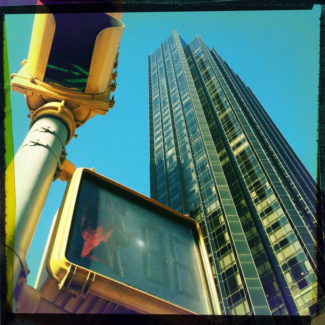 Low angle view of tall building and traffic signal