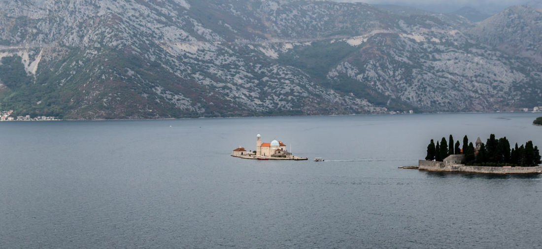 Our Lady of the Rocks Island Beauty In Nature Fjord Island Kotor Lifestyles Mediterranean  Montenegro Mountain Mountain Range Nature Non-urban Scene Our Lady Of The Rocks PERAST Remote River Scenics Tranquil Scene Tranquility Travel Water Waterfront