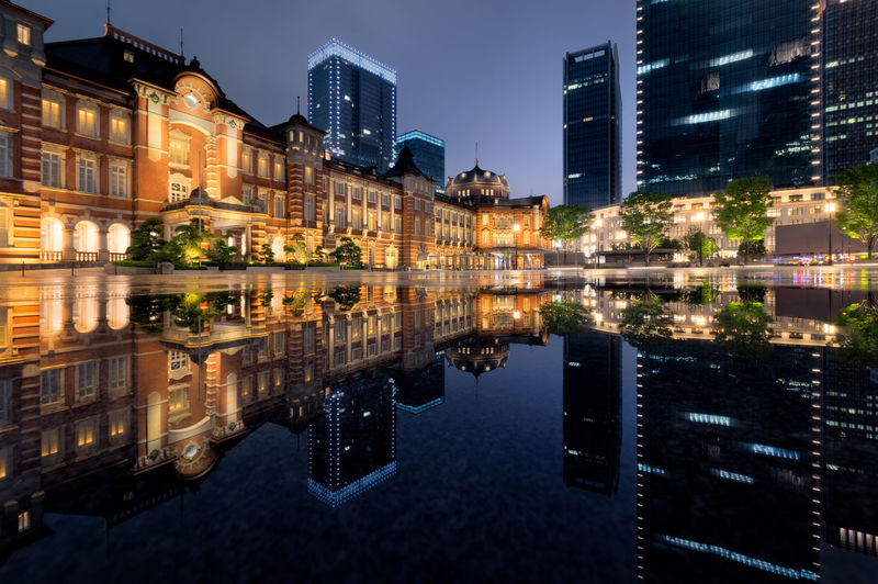 Reflection of illuminated buildings in lake at night
