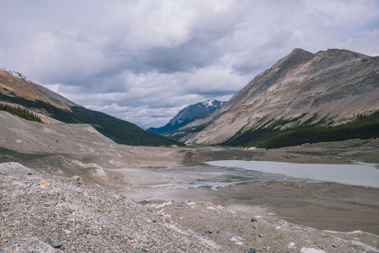 Moraines of the retreating Athabasca Glacier in the canadian rockies Alberta Canadian Rockies  Beauty In Nature Cloud - Sky Columbia Icefield Day Lake Landscape Mountain Mountain Range Nature No People Outdoors Scenery Scenics Sky Tranquil Scene Tranquility Water Wilderness