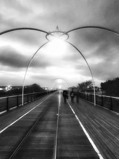 Transportation Sky The Way Forward Architecture Built Structure Arch Outdoors Illuminated Day Beauty In Nature Tree Streetphotography Sunset Street Photography Cloud - Sky Young Adult Leisure Activity Lifestyles Monochrome Blackandwhite Black And White Pier Live For The Story