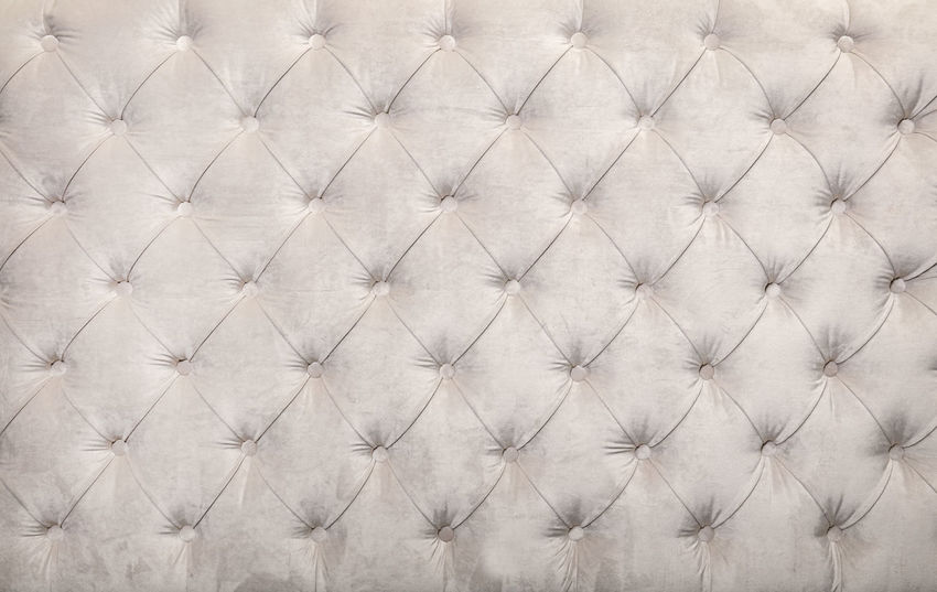 White beige capitone textile tufted background of Chesterfield style sofa headboard Beige Chesterfield Retro Soft Upholstery Abstract Backgrounds Buton Capitone Chesterfield Sofa Close-up Diamond Pattern Fabric Full Frame Headboard Interior Luxury Old-fashioned Pattern Textile Textured  Textured Effect Tufted White