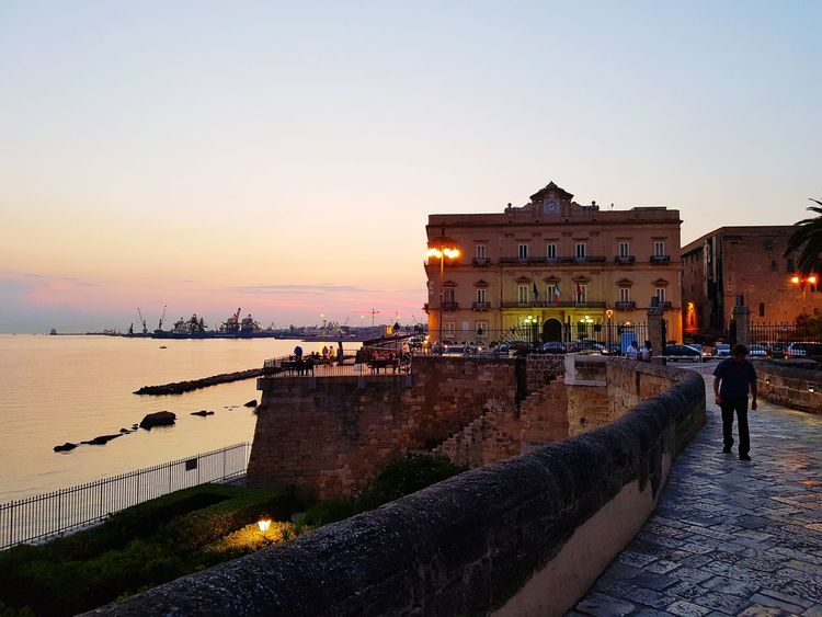 Taranto Taranto Vecchia Tramonto Castello Aragonese Centro Storico Sunset Taranto Italy Taranto Vecchia Castello Aragonese Centro Storico Europe Photography Focus Colors Sunset Sky Saturation EyeEmNewHere EyeEm Nature Lover EyeEm Best Shots Eye4photography  Travel Trip Prospective Point Of View POV Architectureporn City Sunset Sea Clear Sky History Beach Sky Architecture Building Exterior Built Structure City Gate