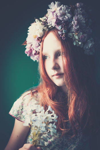 Portrait Of Young Girl Wearing Floral Garland