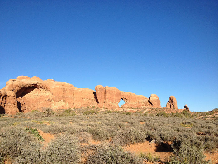 Scenic view of rock formation against clear blue sky