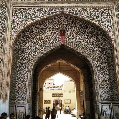 You see one of the main Gates of Jaipurpalace the artwork you see is not inlaid like as in the Taj Mahal Gate Jaipur Rajput Architecture