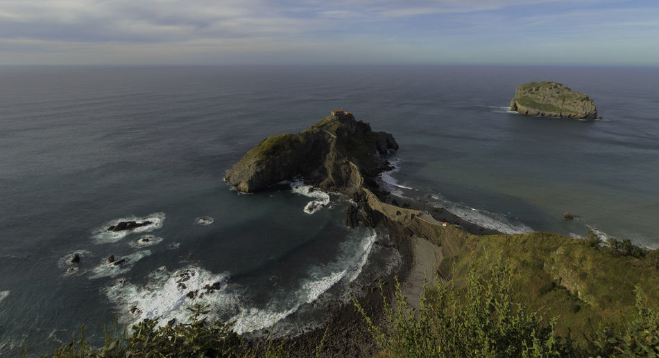 San Juan de Gaztelugatxe in Biscay, in the Basque Country. Sea Beauty In Nature Scenics - Nature Horizon Over Water Rock Horizon Land Cloud - Sky Rock - Object Tranquility Water Sky Beach Nature Basque Country Biscay Landscape Seascape Coastline Landscape Coastline High Angle View Outdoors Cliff