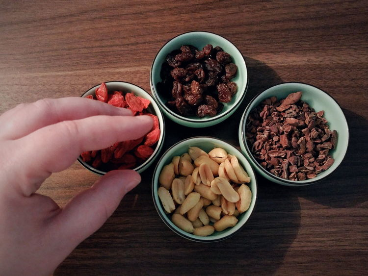 Goji Cacao Peanut Raisin Snack Time! Health Nutrition Healthy Lifestyle Bowl Food And Drink Freshness Human Body Part Food Human Hand Table High Angle View Indoors  Healthy Eating One Person Dried Fruit Raisin People Ready-to-eat Sweet Food Close-up