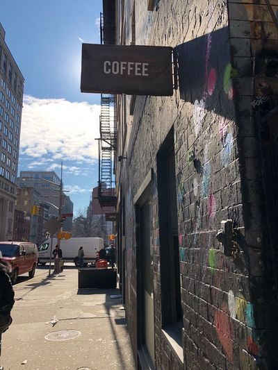 Coffee shop that did not open yet..! Text Western Script Architecture Building Exterior Built Structure Communication Day Outdoors Road Sign Street Guidance One Way City Street Name Sign No People Sky