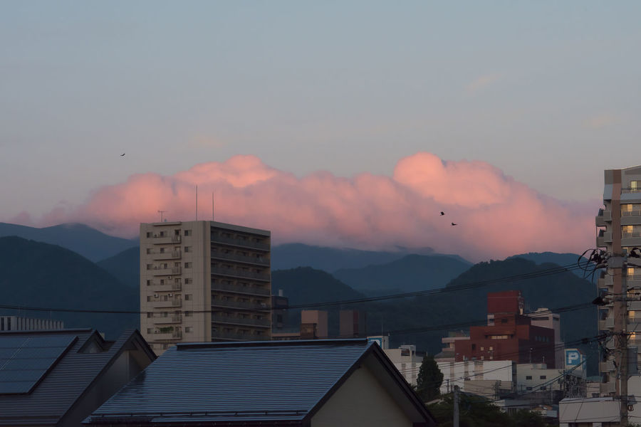Pink cloudy after sunset in Japan, Yamagata. Cloud Porn Cloudscape Japan Sky And Clouds Sunset_collection YAMAGATA Yamagata,Japan Beauty In Nature Building Building Exterior Built Structure City Cloud - Sky Clouds And Sky Environment Mountain Mountain Range Nature No People Outdoors Pink Color Raven - Bird Residential District Sky Sunset HUAWEI Photo Award: After Dark
